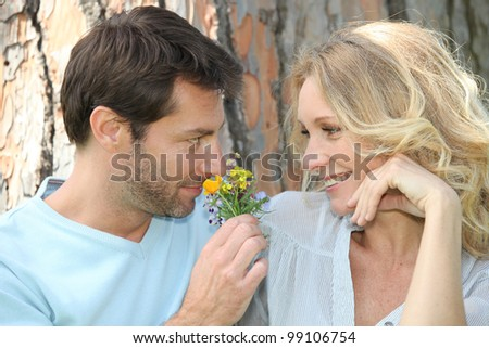 Husband smelling flower