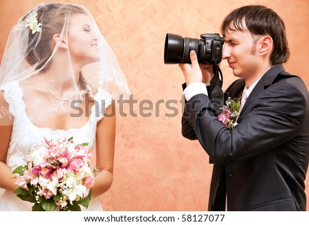 Husband taking picture of his wife on wedding.