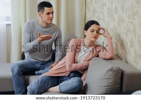 Husband yells at wife, woman is sad ストックフォト ©