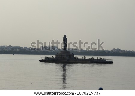 Hussian Sagar Tand Bund lake Hyderabad India water, granite stone, boats, Buddha statue, people, sunset   #1090219937