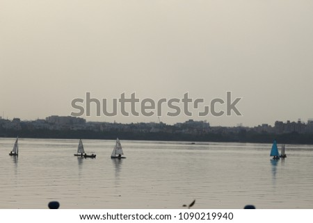 Hussian Sagar Tand Bund lake Hyderabad India water, granite stone, boats, Buddha statue, people, sunset   #1090219940