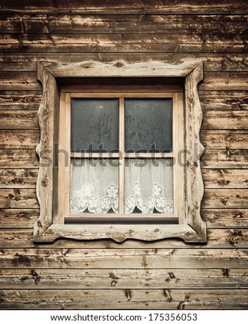 hut and window with curtain  - stock photo