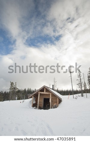 Hut for nordic skiers covered in snow