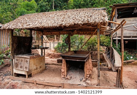Hut in boca de valeria, brazil. Primitive dwelling hut with dried grass roof. Farm or village in tropic with hut. Eco park. Hut architecture. #1402121399