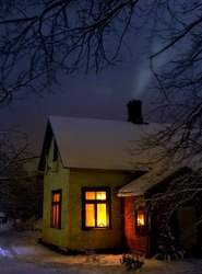 hut in village winter evening scene
