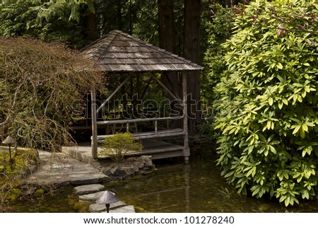 Hut on the water in Japanese Garden with stepping stones