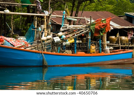 huts and colorful  fisherboats at the mangrove everglades in a small fishermans village in Koh Chang
