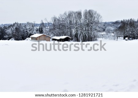 Huts in a wintry landscape #1281921721
