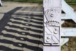 Hutten-Czapsky coat of arms on wooden bridge fence. Stankovo. Belarus.