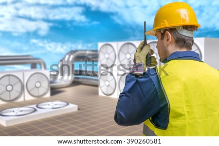 HVAC (Heating, Ventilating, Air Conditioning) maintenance concept. Conditioner units on roof of building and worker.