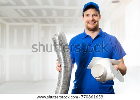 hvac technician ready to install ventilation system in house
