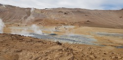 Hverir geothermal area in the north of Iceland near Lake Myvatn, with geothermal lake, looking like Blue Lagoon, Hot Mud Pots and great landscape in the Geothermal Area Hverir, summer day.
