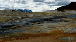 Hverir-surreal geothermal area,Iceland. Namafjall volcanic mountain.The Namaskard geothermal area displays fumaroles,large mud pools, steam vents. Bare Alien martian orangy-red landscape. Unique sight