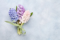 Hyacinth flowers bouquet. Easter greeting card template. Top view flat lay. With space for your greetings