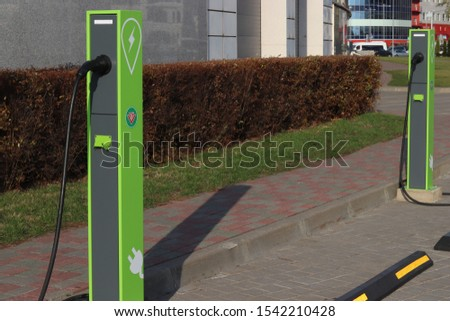 Hybrid and electric car refueling station, for example Tesla with the corresponding signs. Ecological fueling cars. Modernization of the city. Minsk, Belarus - 26 October 2019, Illustrative Editorial #1542210428