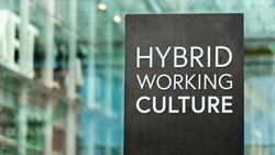 Hybrid Working Culture sign in front of a modern office building