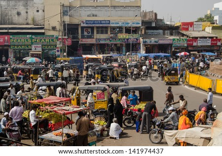 HYDERABAD, ANDHRA PRADESH, INDIA - JANUARY 10: Shoppers and traders at the bustling bazaar by Charminar on January 10 2013.  Hyderabad is one of India\'s most dynamic cities.