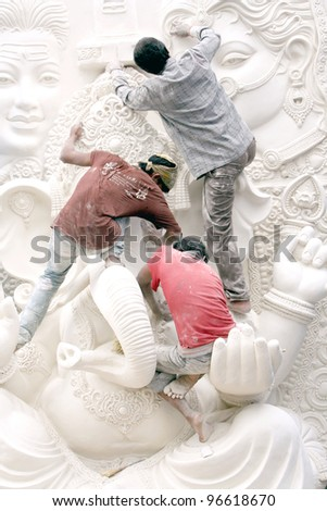 HYDERABAD,AP,INDIA-AUGUST 23:Artists making the ganesha idol for the hindu festival ganesha chathurthi August 23,2011 in Hyderabad,India.Thousands of Idols in different sizes are made every year.