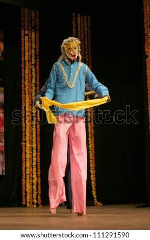 HYDERABAD,AP,INDIA-AUGUST 22:kokali-kattaiA folk dance form dancers perform during world folk art day event in ravindra bharati on August 22,2012 in Hyderabad,Ap,India.3 feet high stilt dance form.