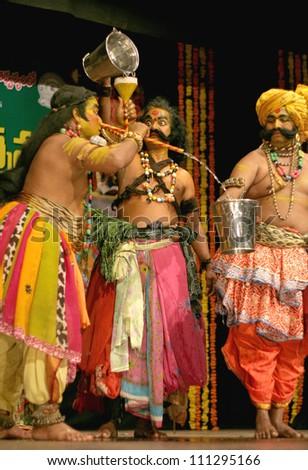 HYDERABAD,AP,INDIA-AUGUST 22: Viranatyam A folk dance form dancers perform during world folk art day event in ravindra bharati on August 22,2012 in Hyderabad,Ap,India.