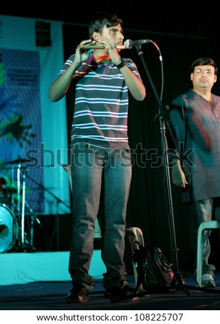 HYDERABAD,AP,INDIA-JUNE 21:Lalit and Nagaraju Perform indian fusion on flute at Alliance Francaise, Goethe Zentrum and HWM foundation World Music Day celebrations on June 21,2012 in Hyderabad,India.