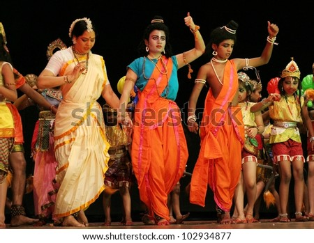 HYDERABAD,AP,INDIA-MAY 15:Dr G Padmaja Reddy of  Pranav Institute with students performs Ramayana dance ballet to non stop Hanuman Chalisa on Hanuman Jayanthi day on May 15,2012 in Hyderabad,Ap,India.