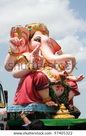 HYDERABAD,AP,INDIA-SEPTEMBER 12:Ganesha idols are being transported for immersion in water bodies on 11th day after Ganesh Chathurthi September 12,2011 in Hyderabad,India.This is an annual event.