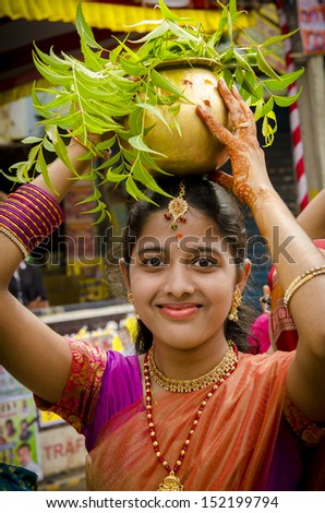HYDERABAD INDIA JULY 28 Unidentified Hindu lady carries decorated pots of offerings and visit Kali temple to celebrate the famous Bonalu festival on 28 July 2013