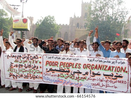 HYDERABAD, PAKISTAN - NOV 28: Activists of Poor People organization chant slogans in favor of their demands during a protest demonstration at Hyderabad press club on November 28, 2010 in Hyderabad.