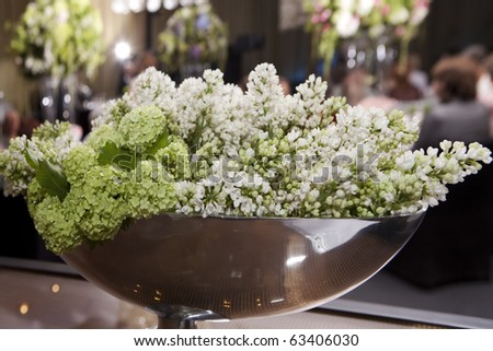 hydrangea and lilac in vase. Decoration of wedding table