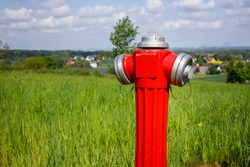 hydrant to connect water on the field, city far in the background. The concept of connections needed in agriculture or in the construction of houses outside the city
