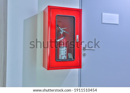 Hydrant with water hoses and fire extinguish equipment. Fire safety equipment in the red box on wall cement . Hydrant with water hoses and fire extinguish equipment , fire hose box .