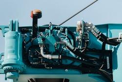 Hydraulic crane engine.The control system of the crane engine.Lifting hydraulic Department on the truck crane.The hydraulic system of the engine.hydraulic hoses on the crane.autoparts.