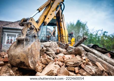 Hydraulic crusher excavator backoe machinery working on site demolition