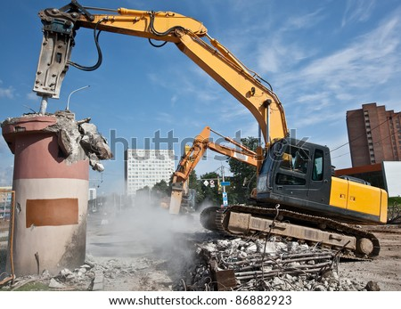 Hydraulic Crushing Hammer demolishing reinforced concrete structures