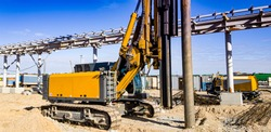 Hydraulic Drilling Rig. The device of bored piles with casing. Foundations and grounds. Drilling in the ground. Technologies.