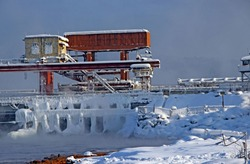 Hydraulic engineering structure on a dam in winter.