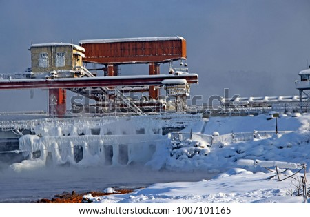 Hydraulic engineering structure on a dam in winter. stock photo