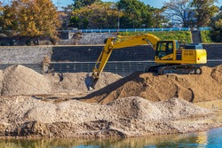 Hydraulic excavator for excavation work on the riverbank