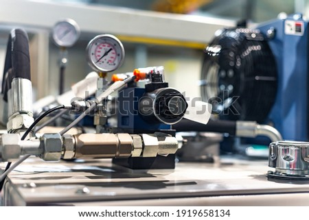 Hydraulic power unit mechanical valve with connection and pressure gauge. Photo stock ©