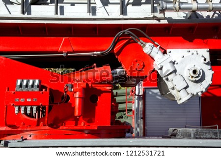 Hydraulic system of lifting and controlling the direction of the fire escape, close-up hydraulics of a fire truck. #1212531721