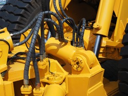 Hydraulics and tow hitch of a large construction machine