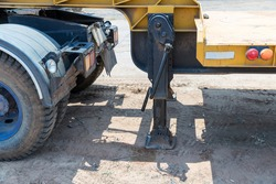 Hydraulics crane support is on ground. Hydraulic outriggers of the crane installed on the truck. Telescopic hydraulic cranes are placed on road for balancing to ensure the stability of the truck crane