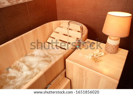 Hydro massage in a wooden bath, for relaxation and relaxation in the Spa