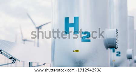 Hydrogen energy storage gas tank with solar panels and wind turbine in background. 3d rendering. Foto stock ©