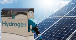 Hydrogen gas station with solar panels and wind turbines in the background. Getting green hydrogen from renewable energy sources