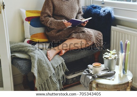 Hygge home interior. Cozy home and cup of coffee #705343405