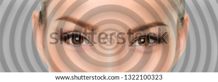 Hypnosis spiral over eyes of woman hypnotized closeup banner panorama. Asian girl portrait background.