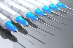 Hypodermic syringe. Syringes with blue needles. Medical Injectors