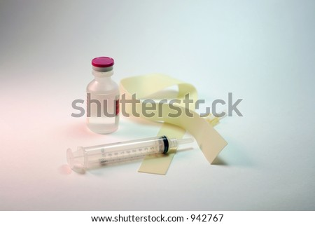 hypodermic syringe, tourniquet, and medicine bottle on clean white background.